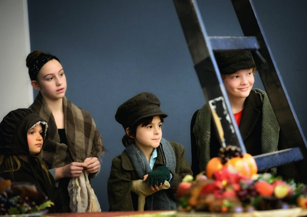 The Cratchit kids (Caitlyn Carroll, Delaney Hunter, Otto Dregni and T.J. McCormick) waited offstage for their scene.