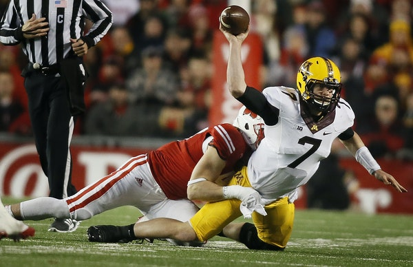 Minnesota Golden Gophers quarterback Mitch Leidner (7)was tackled by Wisconsin Badgers linebacker Vince Biegel (47) in the third quarter Saturday Nove