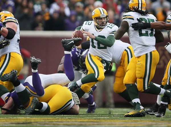 Green Bay Packers quarterback Aaron Rodgers (12) was forced out of the pocket in the second half Sunday November 23, 2014 in Minneapolis , Minnesota.