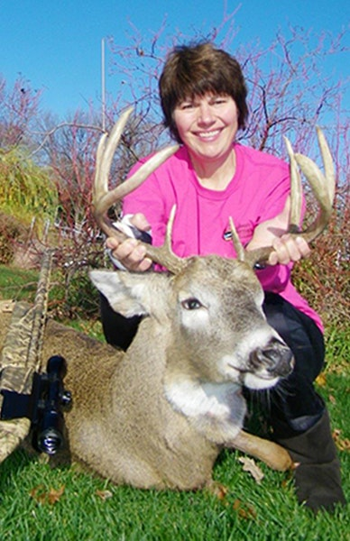 Jane Heinks tore tendons in an arm helping disabled hunters earlier this fall. With a special cast, she was still able to hunt deer last weekend on th