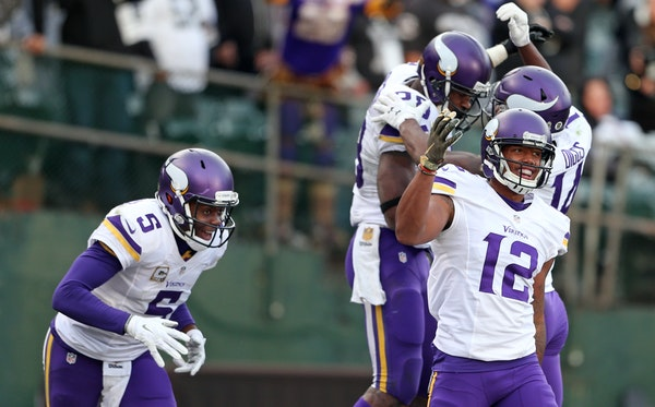 Adrian Peterson celebrated with wide receiver Stefon Diggs (14) in the background as Teddy Bridgewater (5) and Charles Johnson (12) celebrated Peterso