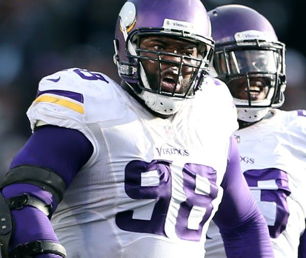 Minnesota Vikings defensive tackle Linval Joseph (98), and tackle Sharrif Floyd (73) celebrated after Joseph sacked Oakland Raiders quarterback Derek
