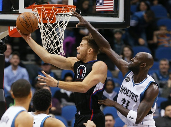Clippers forward Blake Griffin went for a reverse layup as Timberwolves forward Kevin Garnett tried to defend during the first half Monday.