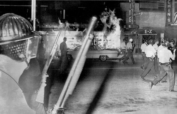 On July 21, 1967, Minneapolis police officers passed a blazing grocery store on Plymouth Avenue on the city's North Side as they began to clear a cr