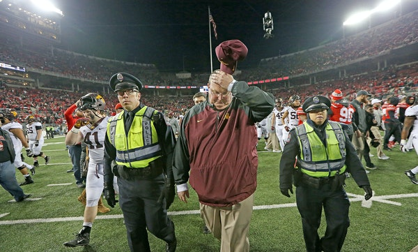 Tracy Claeys made his way off the field after the Minnesota Gophers lost to the Ohio State Buckeyes 28-14 at Ohio Stadium, Saturday, November 7, 2015