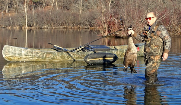 Wendell Diller retrieved a Canada goose — a Christmas goose — felled Wednesday morning during an atypically warm hunt.