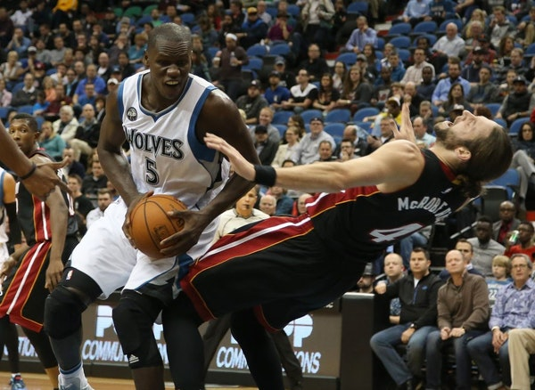 Wolves Gorgui Dieng got called for the offensive foul against Miami's Josh McRoberts during the first half.