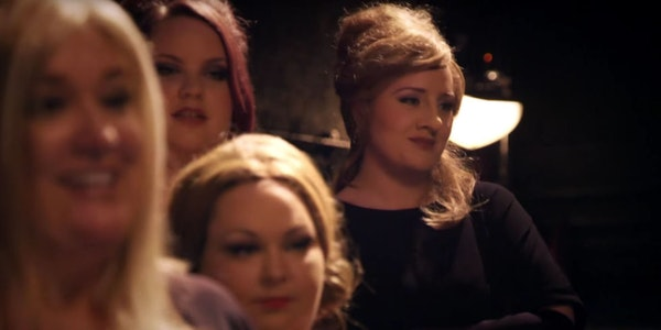 Adele, back, in disguise as Jenny, waits her turn at an audition for Adele impersonators.