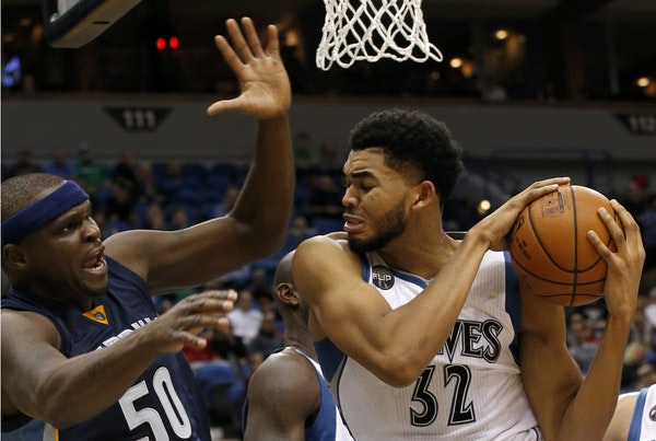 Minnesota Timberwolves center Karl-Anthony Towns (32) pulls down a rebound against Memphis Grizzlies forward Zach Randolph (50) during the second half