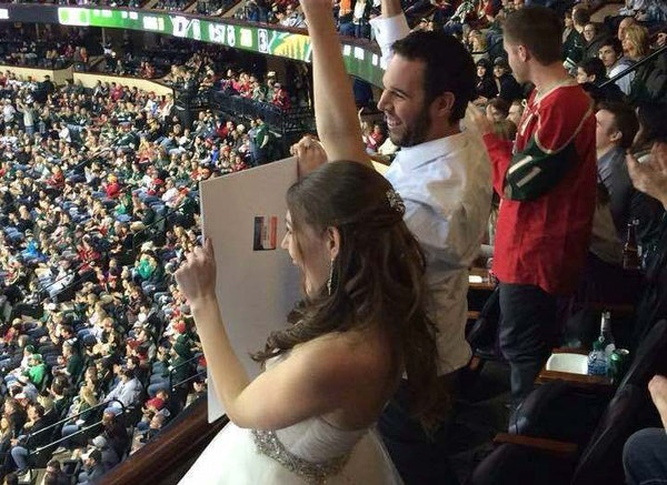 """Wild fans Erica Skuta and Lewis Blake attended the game against the Dallas Stars as their """"wedding finale."""""""