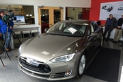A self-driving Tesla is on display in the west metro area.