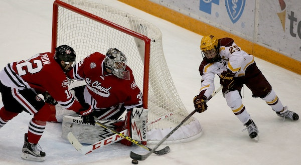 Gophers captain Justin Kloos made his way around the net to try to score against St. Cloud State goalie Charlie Lindgren during the first period on No