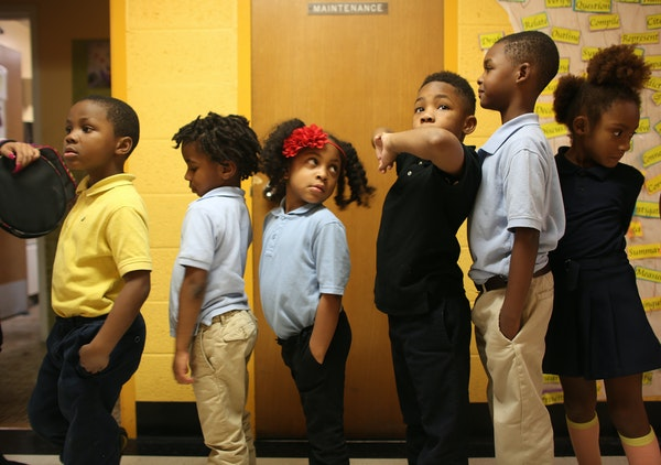 Kindergartners waited in line at Friendship Academy of the Arts in Minneapolis, where the student body is 95 percent black.