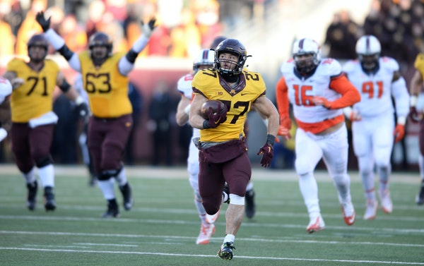 Gophers running back Shannon Brooks (27) ran the ball for a 75-yard touchdown late in the fourth quarter against Illinois.