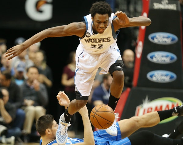 Timberwolves guard/forward Andrew Wiggins chased a loose ball down as the Magic's Nikola Vucevic fell to the floor at Target Center on Monday night.