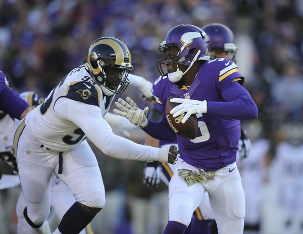 Vikings quarterback Teddy Bridgewater (5) was pursued by Rams defensive end William Hayes (95) in the third quarter Sunday afternoon. Hayes hit Bridge
