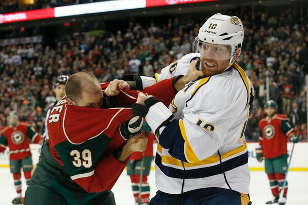 Nashville Predators left wing James Neal (18) and Minnesota Wild defenseman Nate Prosser (39) fight during the second period of an NHL hockey game in