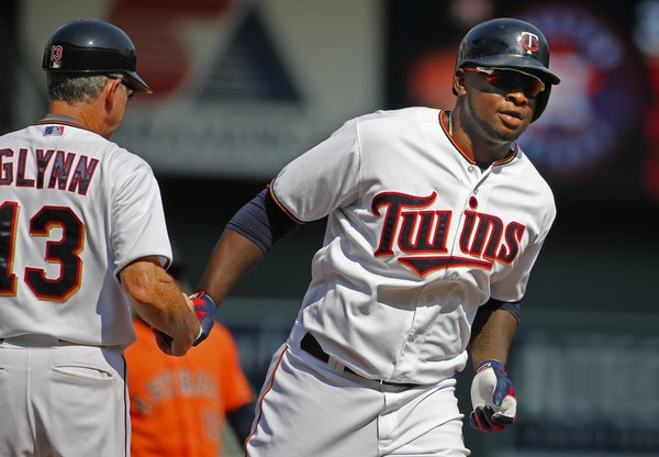 Twins rookie designated hitter Miguel Sano, right