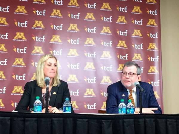 """University of Minnesota President Eric Kaler, right, with interim A.D. Beth Goetz, seeks a strong """"tone at the top"""" in a new athletic director."""