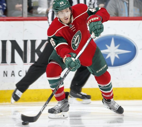 Jared Spurgeon, controlling the puck against Toronto on Dec. 3, is in contract talks with the Wild, along with Jason Zucker. Spurgeon, Zucker and Matt