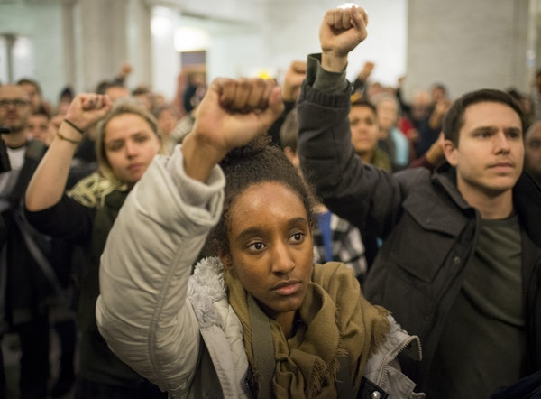 Activist Netsanet Negussie raised her hand in solidarity during Thursday night's protest at Minneapolis City Hall.