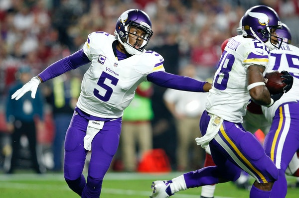 Vikings quarterback Teddy Bridgewater (5) hands the ball off to Adrian Peterson (28) in the second quarter against the Arizona Cardinals on Thursday,