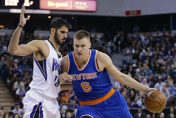 New York Knicks forward Kristaps Porzingis, right,of Latvia, drives against Sacramento Kings forward Omri Casspi, of Israel, during the first quarter