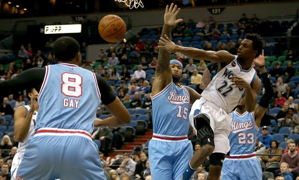 Andrew Wiggins passed the ball after driving to the basket during the first half.