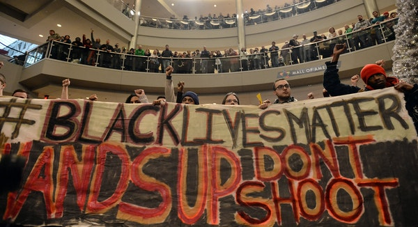 """Demonstrators filled the Mall of America rotunda and chanted """"Black lives matter"""" to protest police brutality, Saturday, Dec. 12, 2014, in Bloomington"""