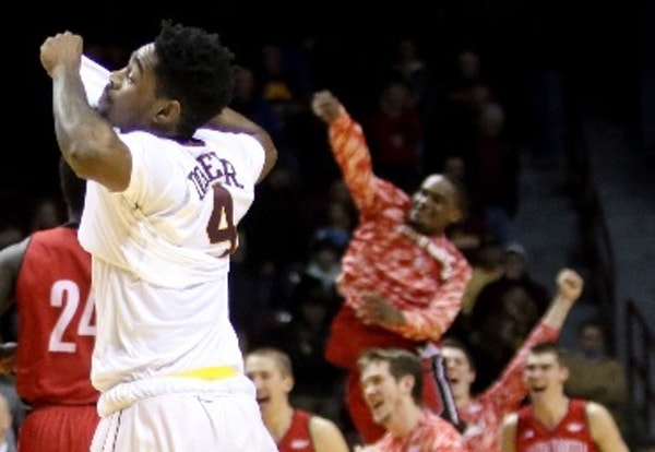 The Gophers' Kevin Dorsey Jr. (4) walked off the court as University of South Dakota players celebrated their 85-81 double overtime win at Williams Ar