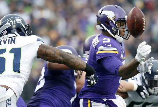 Seattle's Bruce Irvin (51) disrupted a pass by Vikings quarterback Teddy Bridgewater in the third quarter.
