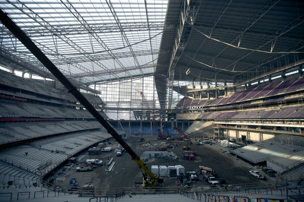 Three layers of slick, translucent plastic and two air pillows stretch over the steel roof supports of the new Vikings stadium.