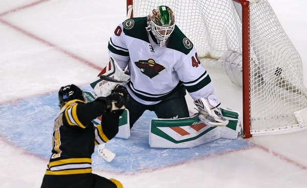 Boston Bruins left wing Loui Eriksson shoots his third goal of the game past Minnesota Wild goalie Devan Dubnyk (40) during the third period of an NHL