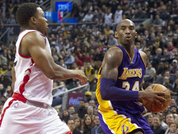 In a rare burst of his former self, Kobe Bryant slashed past Raptors guard Kyle Lowry during Monday's game.