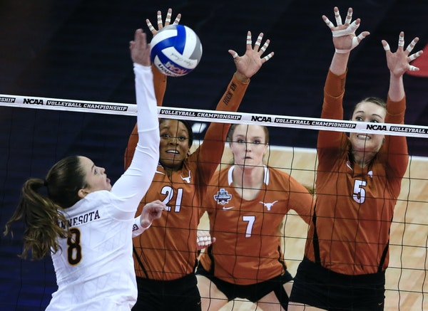 The Gophers' Sarah Wilhite tried to spike the ball past the outreached hands of Texas' Chloe Collins (21) and Molly McCage.