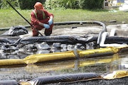 Enbridge's 2010 pipeline rupture in Marshall, Mich., above, that spilled 843,000 gallons of dilbit into a Kalamazoo River tributary is cited in new