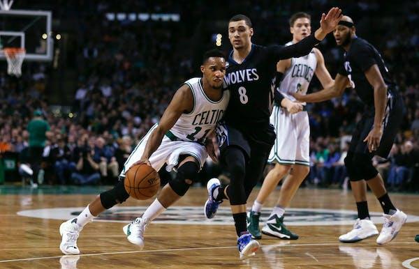 Boston Celtics guard Evan Turner (11) drives to the basket past Minnesota Timberwolves guard Zach LaVine (8) during the first quarter of an NBA basket