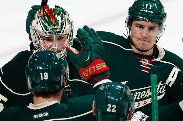 Wild goalie Darcy Kuemper, left, received congratulations from Zach Parise, right, Jarret Stoll (19) and Nino Niederreiter (22) after stopping 24 of 2