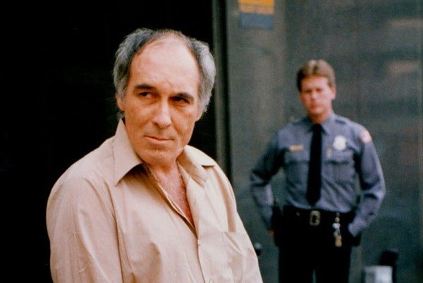 Billy Glaze walked out of the federal building in Minneapolis after a court hearing on April 1, 1988, accompanied by U.S. marshals.
