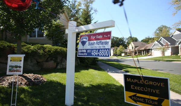 Signs point out an open house in Maple Grove in August.