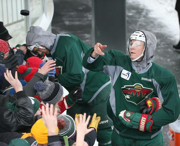Wild captain Mikko Koivu flipped pucks to fans after practice Tuesday at the outdoor ice rink by Braemar Arena in Edina.