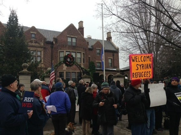 About 100 people rallied Sunday, Dec. 6, at the governor's residence in St. Paul to support leaving the state open to Syrian refugees seeking asylum i