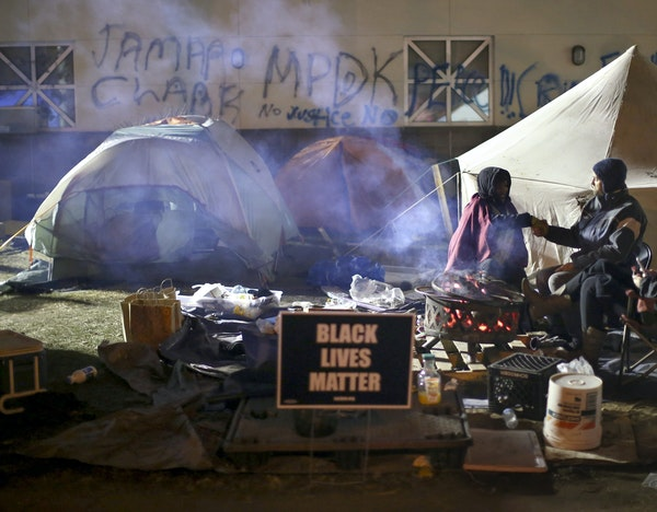 A rally after the shooting of Jamar Clark on Nov. 15 had turned into an encampment at Fourth Precinct headquarters by Nov. 19.