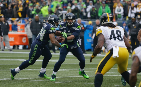 Hand it off or keep it? That's the choice Seahawks QB Russell Wilson makes in every read-option play, this one with rookie Thomas Rawls.