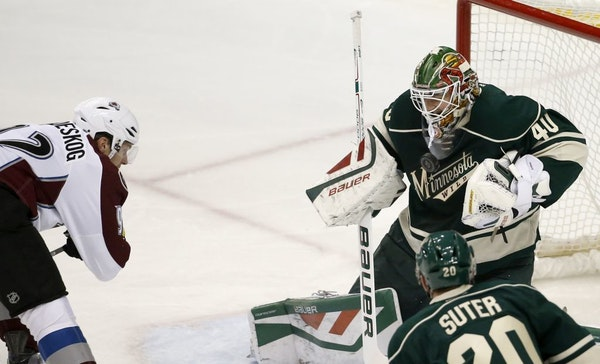 Wild goalie Devan Dubnyk deflected a shot by Avalanche left wing Gabriel Landeskog during the first period Saturday. Dubnyk wouldn't make it through t