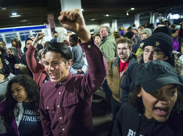 Black Lives Matter protesters made their way from the Mall of America to Terminal 2 of MSP via light rail on Wednesday