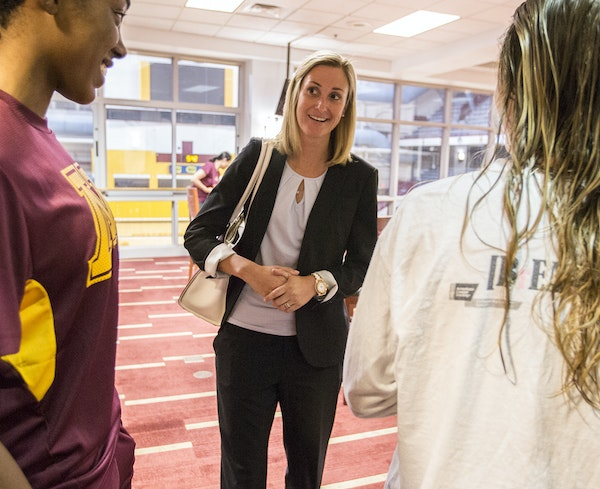 University of Minnesota interim athletic director Beth Goetz chatted with members of the women's volleyball team at Williams Arena.