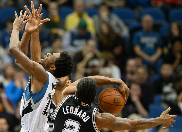 Andrew Wiggins, who had just 10 points, had his shot blocked five times Wednesday, this one by Spurs forward Kawhi Leonard.
