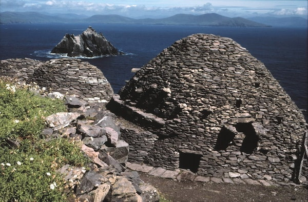 Stone beehive huts atop barren Skellig Michael gave shelter from the years 650 to 1250 to hardy monks in Ireland who sought a close connection to God.