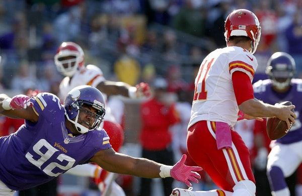 Tom Johnson (92) pressured Chiefs quarterback Alex Smith (11) in the fourth quarter of their game in October.